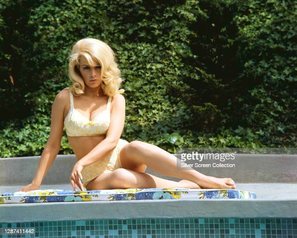 American actress Stella Stevens by a swimming pool, circa 1965.