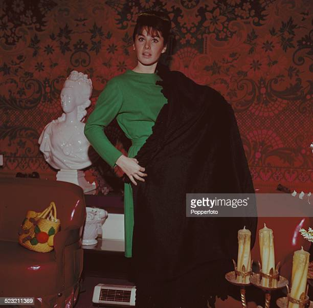 American actress Stephanie Powers posed wearing a green dress with a black shawl wrapped around her in 1963