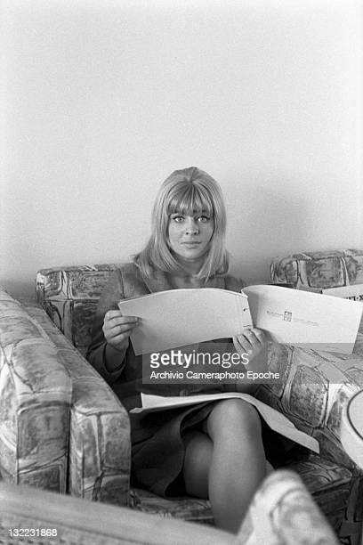 American actress Sue Lyon sitting on a sofa and reading a booklet Lido Venice 1973