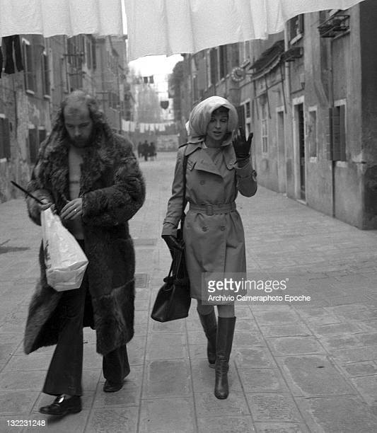 American actress Sue Lyon walking in Venice wearing a scarf around her head Venice 1973