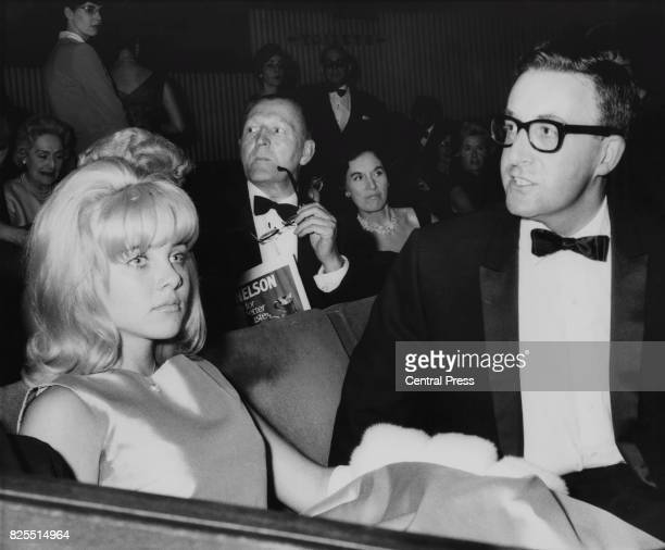American actress Sue Lyon with costar Peter Sellers at the premiere of the film 'Lolita' at the Columbia Theatre in London 6th September 1962
