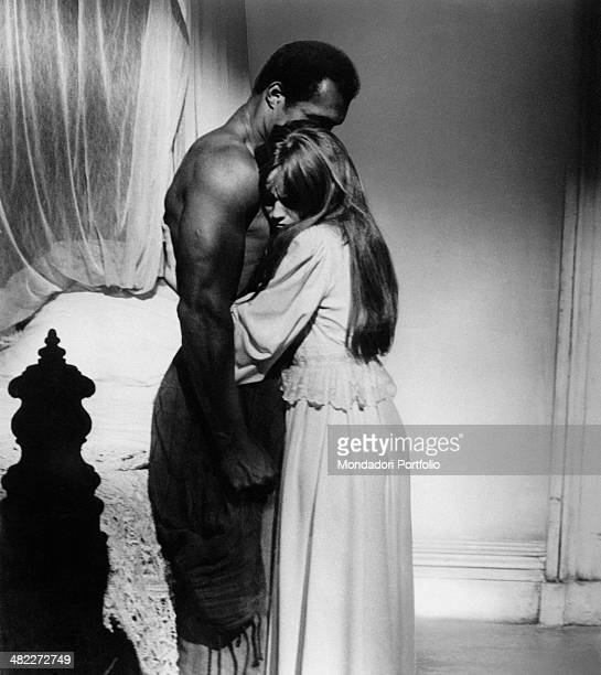 American actress Susan George revealing to American boxer and actor Ken Norton to be pregnant in the film Mandingo 1975
