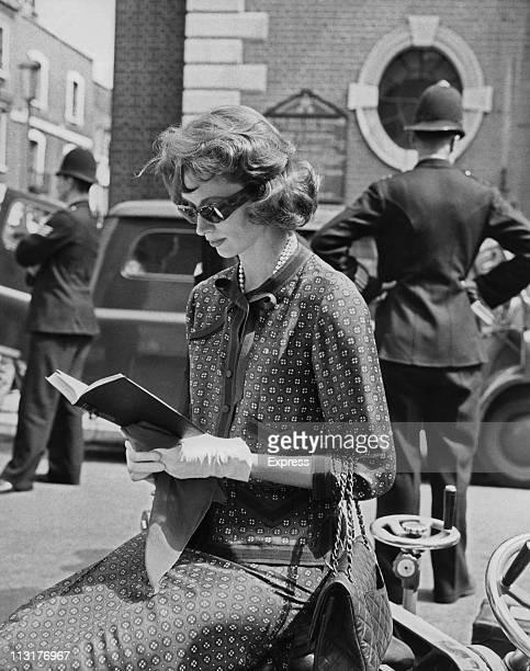 American actress Suzy Parker taking a break from filming on the set of 'A Circle of Deception' being shot in Chelsea London on August 05 1960
