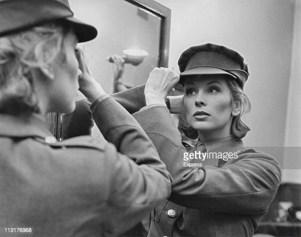 American actress Suzy Parker trying on a costume for the film 'A Circle of Deception' in a Saville Row tailors in London on July 28 1960
