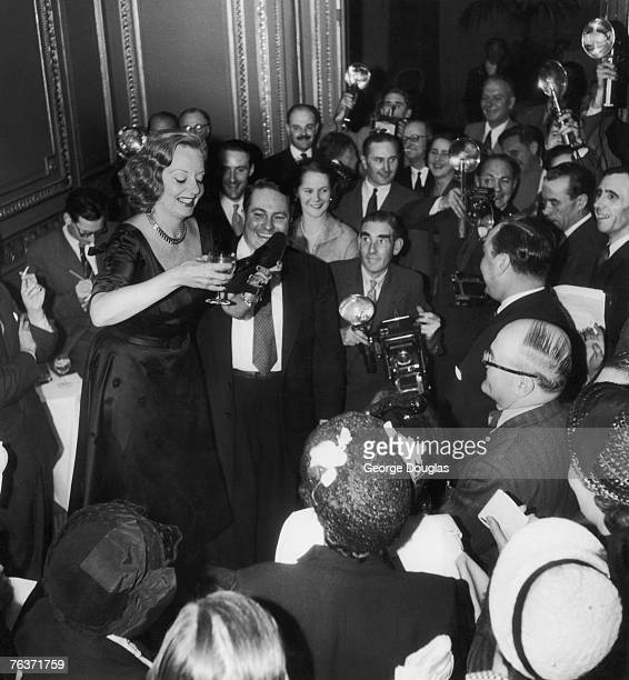 American actress Tallulah Bankhead drinks champagne from her shoe during a press conference at the Ritz Hotel in London 7th September 1951 Original...
