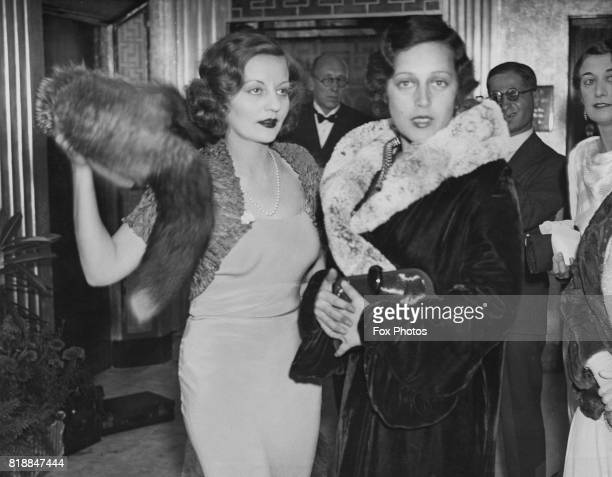 American actress Tallulah Bankhead with a friend at the premiere of the film 'The Private Life of Don Juan' at the New London Pavilion 6th September...