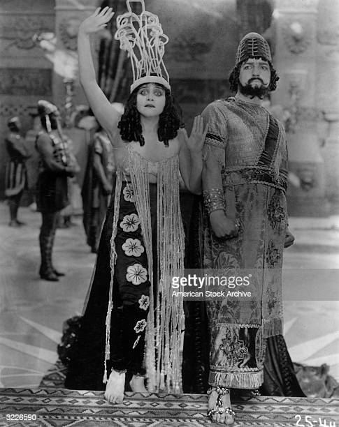 American actress Theda Bara with G. Raymond Nye as King Herod in a still from director J. Gordon Edwards's silent film 'Salome', . Bara wears a...