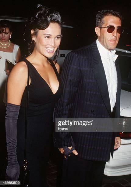 American actress Tia Carrere with her partner nightclub owner Elie Samaha circa 1992