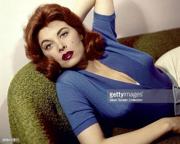 American actress Tina Louise reclining on a sofa circa 1958