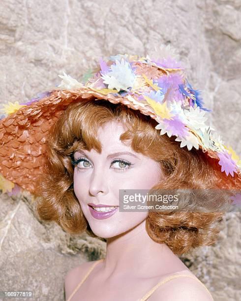 American actress Tina Louise wearing a multicoloured sunhat circa 1965