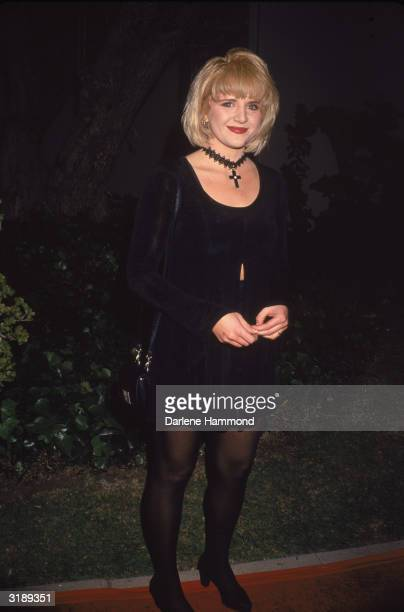 American actress Tina Yothers poses outside an unspecified event 1994