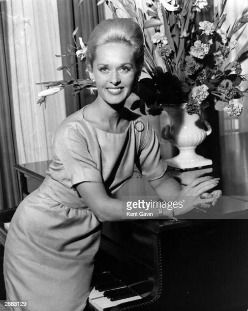 American actress Tippi Hedren who was discovered by film producer Alfred Hitchcock in England for the premiere of his new film 'The Birds' in which...