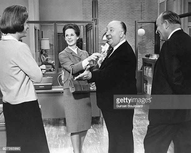 American actress Tippi Hedren with British director and producer Alfred Hitchcock on the set of his movie Marnie based on the novel by Winston Graham