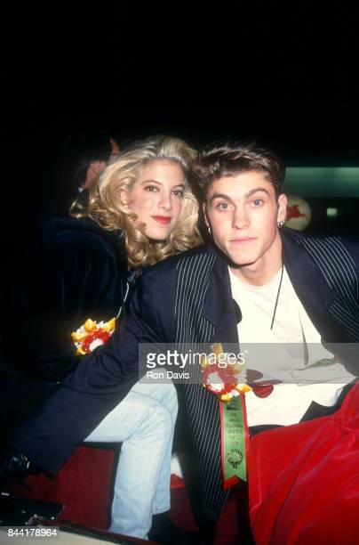American actress Tori Spelling and American actor Brian Austin Green pose for a portrait during the 61st Annual Hollywood Christmas Parade on...