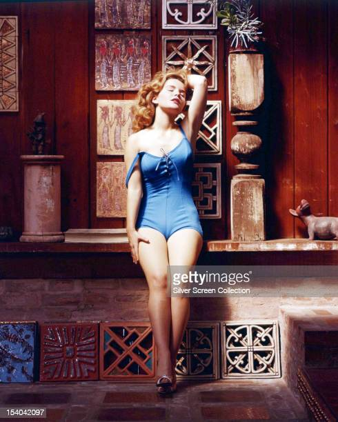 American actress Tuesday Weld posing among a selection of decorative tiles in a blue onepiece swimsuit circa 1963