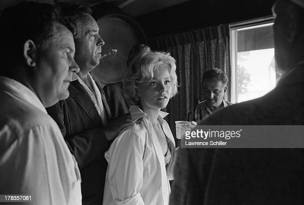 American actress Tuesday Weld stands with unidentified others during the production of her film 'Soldier in the Rain' Fort Ord California 1963
