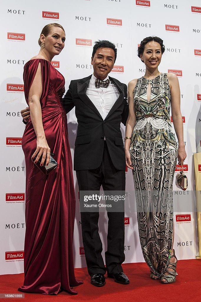 American actress Uma Thurman (L), Hong Kong actor Donnie Yin (C) and Cissy Wang (R) attend at the Moet & Chandon and FilmAid Asia Power of Film Gala at Clear Water Bay Film Studios on March 16, 2013 in Hong Kong, Hong Kong.