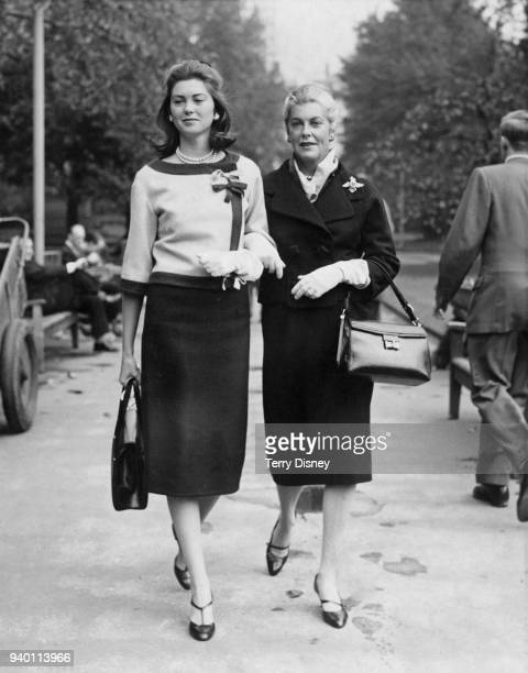 American actress Veronica Cooper , the wife of actor Gary Cooper, walking in Embankment Gardens, London, with their daughter Maria, 29th September...
