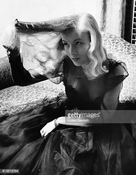 American actress Veronica Lake plays with her hair 1941