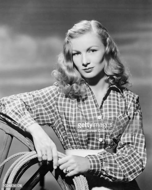 American actress Veronica Lake wearing a plaid shirt and holding a rope circa 1945