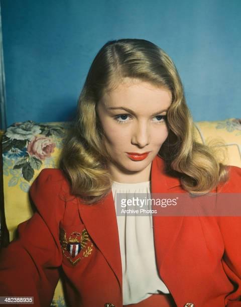 American actress Veronica Lake wearing a red blazer circa 1950