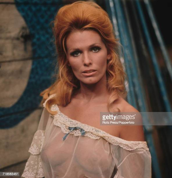 American actress Victoria George who appears in the film 'The Last Rebel' pictured wearing a sheer almost transparent negligee style dress in her...