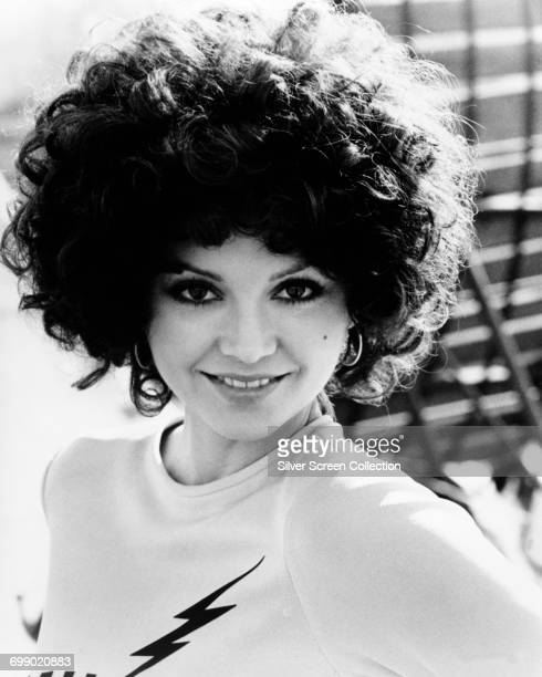 American actress Victoria Principal wears a top emblazoned with a lightning bolt as Rosa Amici in a publicity still for the disaster film...