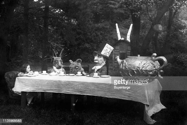 American actress Viola Savoy as the title character appears in the Mad Hatter's Tea Party scene from 'Alice in Wonderland' New York 1915 Also...