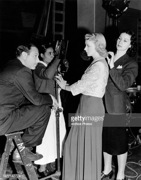 American actress Virginia Bruce being prepared for her role in the MGM film Penthouse' later titled 'Society Lawyer' circa 1939 The film's director...