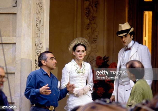 American actress Winona Ryder and British actor Daniel DayLewis with director Martin Scorsese on the set of his movie The Age of Innocence based on...