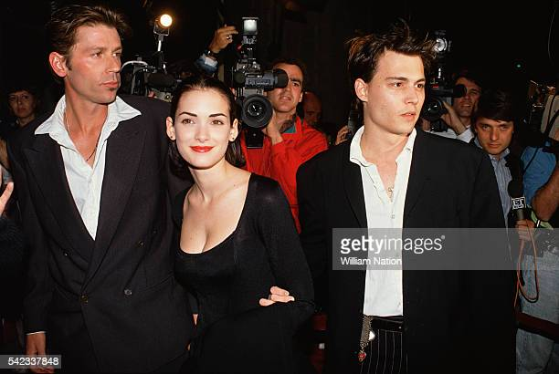 American actress Winona Ryder and her partner actor Johnny Depp attend the premiere of the movie Mermaids directed by Richard Benjamin