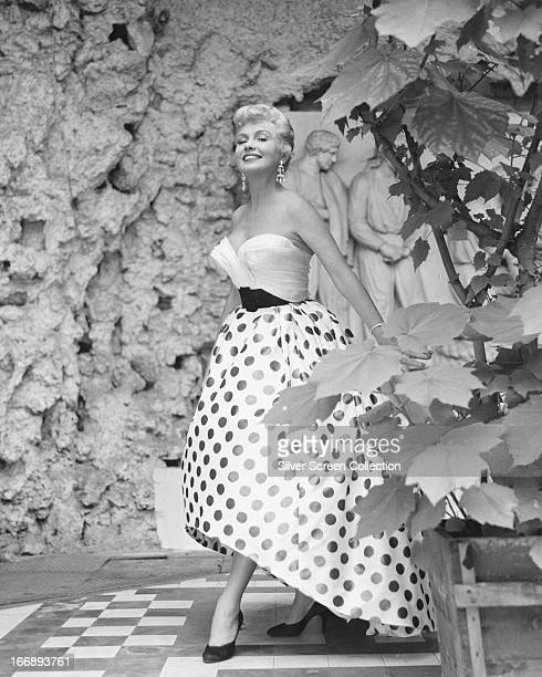 American actress Yolande Donlan wearing a polka dot skirt circa 1955