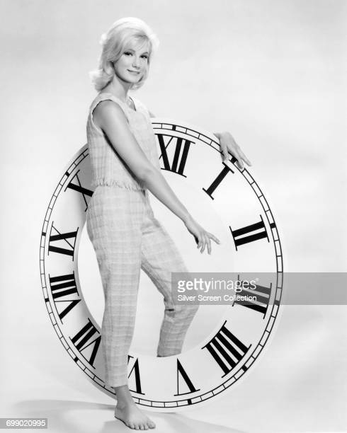 American actress Yvette Mimieux poses by a large clock circa 1960 She starred as Weena in the 1960 science fiction film 'The Time Machine'