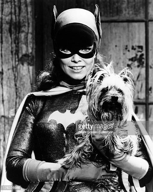 American actress Yvonne Craig as Batgirl/Barbara Gordon in the TV series 'Batman' circa 1967 Craig is holding her pet Yorkshire Terrier Sebastian
