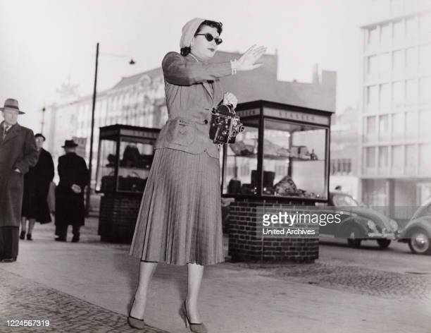 American actress Yvonne de Carlo with a film camera at Berlin Germany 1957