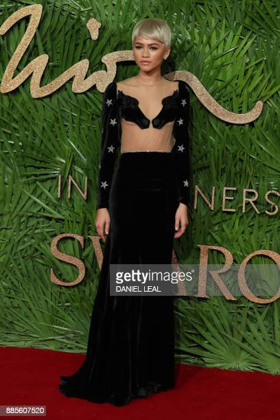 American actress Zendaya pose on the red carpet upon arrival to attend the British Fashion Awards 2017 in London on December 4 2017 / AFP PHOTO /...