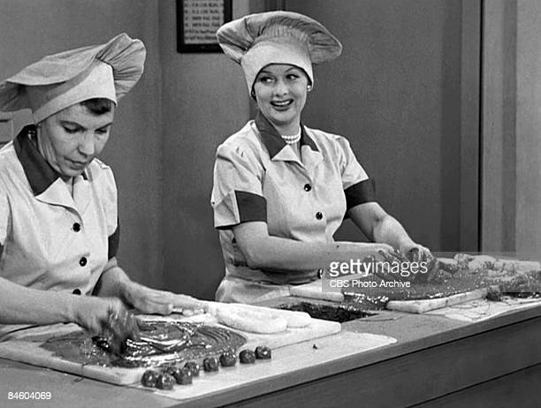 American actresses Amanda Milligan , as Candy Dipper, and Lucille Ball , as Lucy Ricardo, work side-by side in a candy factory on an episode of the...