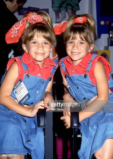 American actresses and twins MaryKate Olsen and Ashley Olsen attend the 12th Annual Video Software Dealers Association Convention and Expo on July 11...