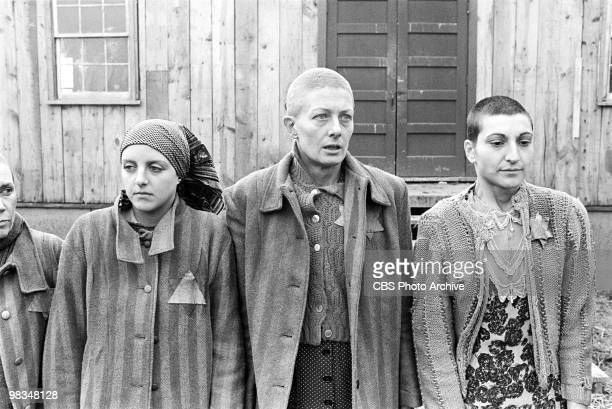American actresses Anna Levine and Robin Bartlett flank British actress Vanessa Redgrave in a scene from the madefortelevsion film 'Playing for Time'...