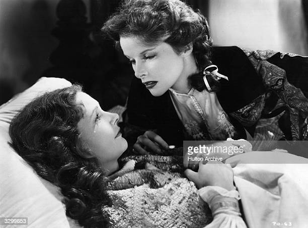 American actresses Elizabeth Allan formerly Elizabeth Gillease and Katharine Hepburn in a scene from the film 'A Woman Rebels' about a Victorian...