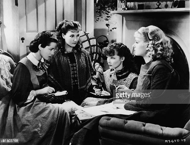American actresses Frances Dee Jean Parker Katharine Hepburn and Joan Bennett sit and glare at one another as the March girls in this still from a...