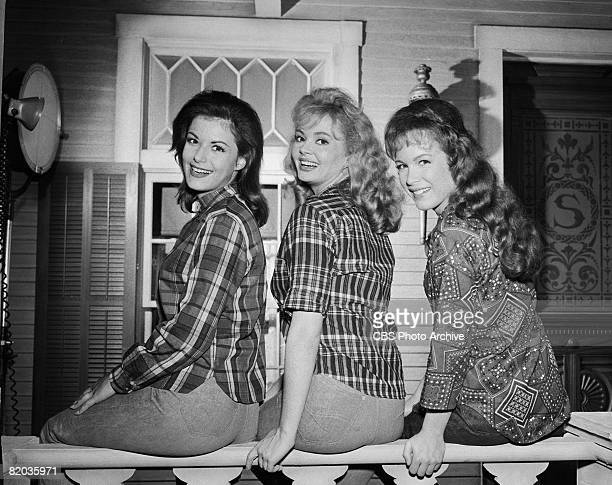 American actresses from left Pat Woodell Jeannine Riley Linda Henning pose for a portrait on the railing of the porch set of 'Petticoat Junction'...