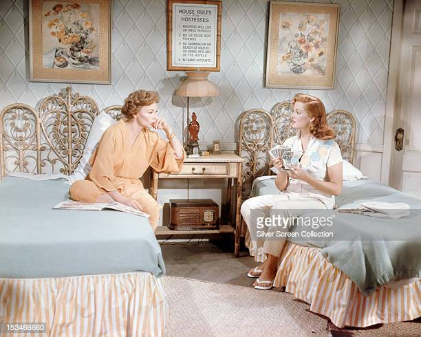American actresses Jeanne Crain and Jane Russell in a scene from 'Gentlemen Marry Brunettes' directed by Richard Sale 1955