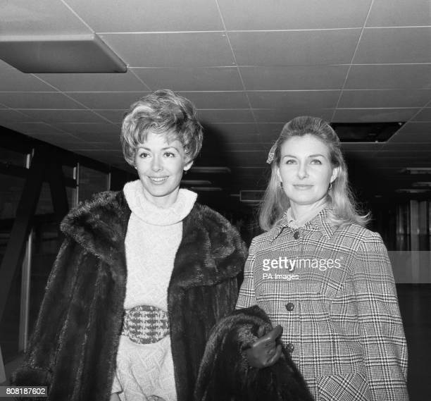 American actresses Joanne Woodward right and Barbara Rush at Heathrow Airport