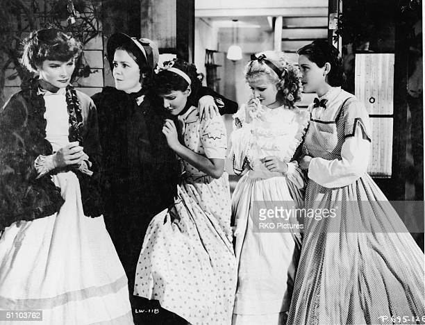 American actresses Katharine Hepburn Spring Byington Jean Parker Joan Bennett and Frances Dee crying in character as the March women in a still from...