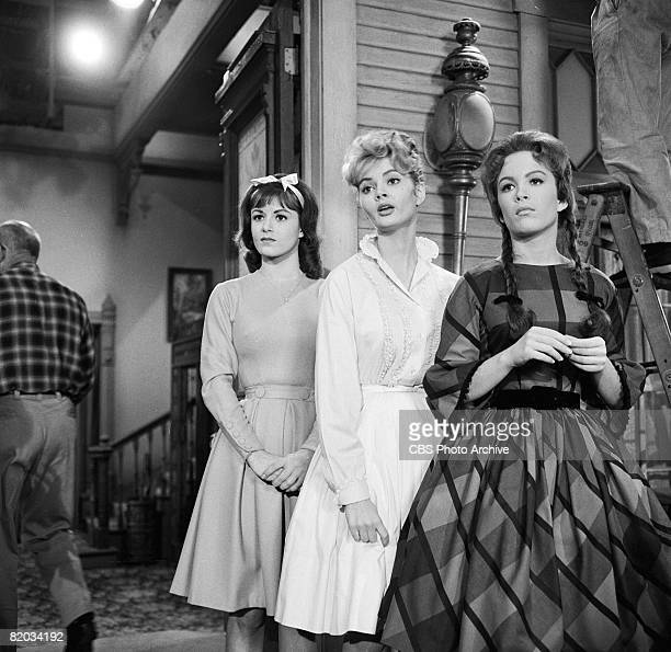 American actresses Linda Henning Jeannine Riley and Pat Woodell stand together on the set of 'Petticoat Junction' during the filming of an episode...