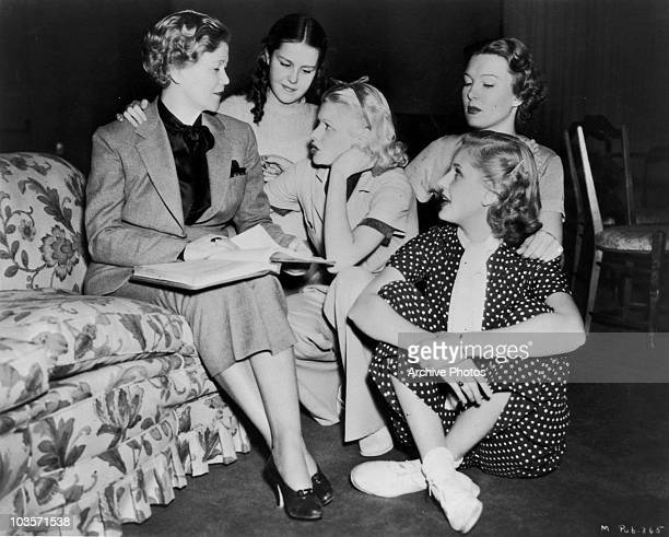 American actresses Lucille Ball and Cathy Lewis take advice from Lela Rogers circa 1940