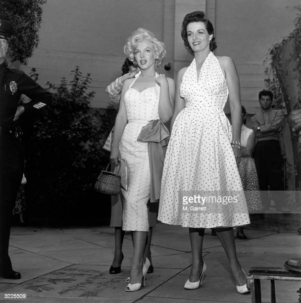 American actresses Marilyn Monroe and Jane Russell stand in the courtyard of Grauman's Chinese Theater as they promote director Howard Hawks's film...