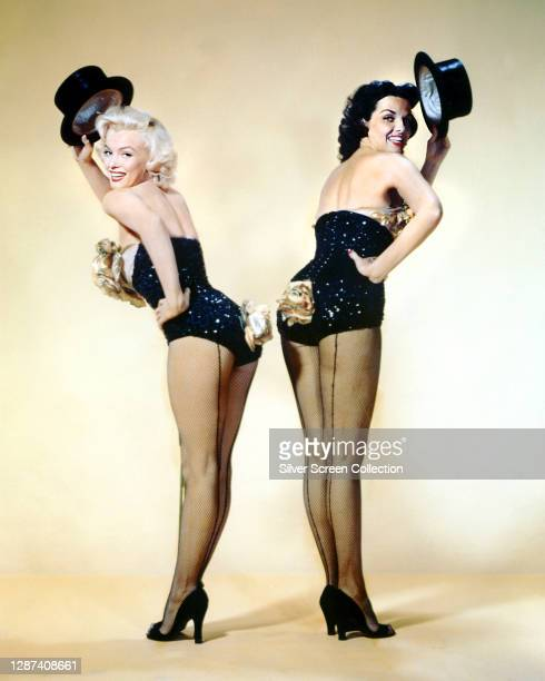 American actresses Marilyn Monroe as Lorelei Lee and Jane Russell as Dorothy Shaw in a promotional portrait for the musical comedy film 'Gentlemen...