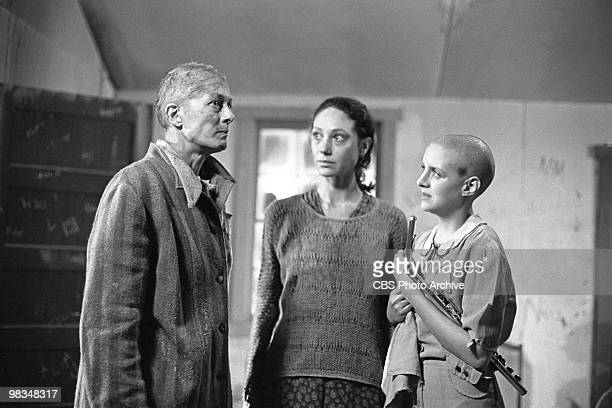American actresses Marisa Berenson and Anna Levine watch British actress Vanessa Redgrave in a scene from the madefortelevsion film 'Playing for...